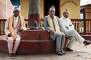 Three Hindu pandit (religious holy men) who have agreed to stop solemnizing child marriages (L-R) Dharma Raj Regmi (57), Narain Prasad Sharma (57), and Tulasi Prasad Sharma (47), at the Shiva Temple in Chhinchu, Surkhet district, Western Nepal, on 1st July 2012. Narain says that people are afraid of talking marrying their underaged children in front of them because of their strong stance against it. Tulasi Prasad was Tulasa Khadka's school teacher and was so much against Khadka's decision to get married at 13 that he was estranged from the family. Dharma has 3 daughters, all active in the local and district level Child Clubs, supported by Save the Children and their local partner NGO Safer Society, that advocates for child rights and against child marriages. Photo by Suzanne Lee for Save The Children UK