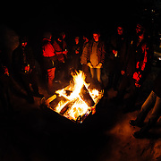 Spectators hangout by the fire pit during Hostel X team practice.