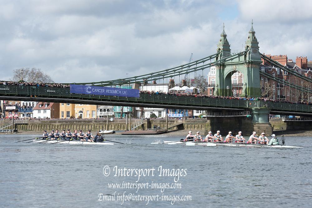 London. UNITED KINGDOM.  Both crews approaching Hammersmith Bridge.  The 71st Newton Women's Boat Race on the Championship Course, River Thames, Putney/Mortlake.  Sunday  27/03/2016    [Mandatory Credit. Intersport Images]<br /> <br /> Oxford University Women's Boat Club {OUWBC} vs Cambridge University Women's Boat Club {CUWBC} <br /> <br /> Oxford, Crew Cox &ndash; Morgan Baynham-Williams, Stroke &ndash; Lauren Kedar, 7 &ndash; Maddy Badcott, 6 &ndash; Anastasia Chitty, 5 &ndash; Elo Luik, 4 &ndash; Ruth Siddorn, 3 &ndash; Joanneke Jansen, 2 &ndash; Emma Spruce, Bow &ndash; Emma Lukasiewicz<br /> <br /> Cambridge, Crew Bow Ashton Brown, 2 Fiona Macklin, 3 Alice Jackson, 4 Thea Zabell, 5 Daphne Martschenko, 6 Myriam Goudet, 7 Hannah Roberts, Stroke Zara Goozee, Cox Rosemary Ostfeld.