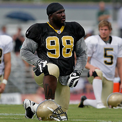 04 August 2009: New Orleans Saints defensive tackle Sedrick Ellis (98) stretches before practice during New Orleans Saints training camp at the team's practice facility in Metairie, Louisiana.