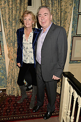 LORD & LADY LLOYD-WEBBER at a party to celebrate the publication of Right or Wrong: The Memoirs of Lord Bell held at Mark's Club, Charles Street, London on 16th October 2014.