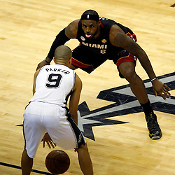 Jun 16, 2013; San Antonio, TX, USA; Miami Heat small forward LeBron James (6) defends San Antonio Spurs point guard Tony Parker (9) during the second quarter of game five in the 2013 NBA Finals at the AT&T Center. Mandatory Credit: Derick E. Hingle-USA TODAY Sports