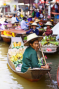 Fruit seller in the Damnern Saduak floating market, Bangkok, Thailand
