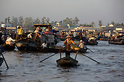 Mekong Delta. Early morning at Cai Rang Floating Market on Can Tho River. Traditional rowing boats.