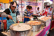 Chatuchak Weekend Market food vendor stall; Bangkok, Thailand. (Largest market in Thailand).