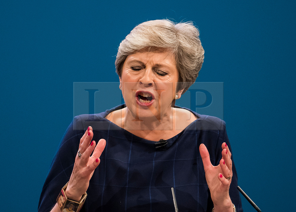 © Licensed to London News Pictures. 04/10/2017. Manchester, UK. British prime minister THERESA MAY delivering her leaders speech on the final day of the Conservative Party Conference. The four day event is expected to focus heavily on Brexit, with the British prime minister hoping to dampen rumours of a leadership challenge. Photo credit: Ben Cawthra/LNP