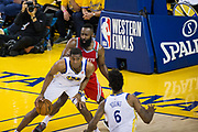 Golden State Warriors forward Kevon Looney (5) looks for an open teammate during Game 6 of the Western Conference Finals against the Houston Rockets at Oracle Arena in Oakland, Calif., on May 26, 2018. (Stan Olszewski/Special to S.F. Examiner)