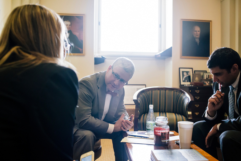 U.S. Rep. Patrick McHenry (R-N.C.), the chief deputy whip of House Republicans, meets with his staff to secure votes for an upcoming bill at his office in the U.S. Capitol on April 23, 2015. McHenry is considered one of the fastest-rising stars of House Republicans.