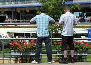© Licensed to London News Pictures. 19/06/2012. Ascot, UK  Two men wear shorts and jeans with short sleeve shirts, breaking the fashion rules. . Day one at Royal Ascot 19 June 2012. Royal Ascot has established itself as a national institution and the centrepiece of the British social calendar as well as being a stage for the best racehorses in the world.. Photo credit : Stephen Simpson/LNP