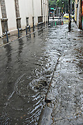 Raw sewage flows from a street drain during a rainy day in the Centro district neighborhood in Rio de Janeiro, Brazil.
