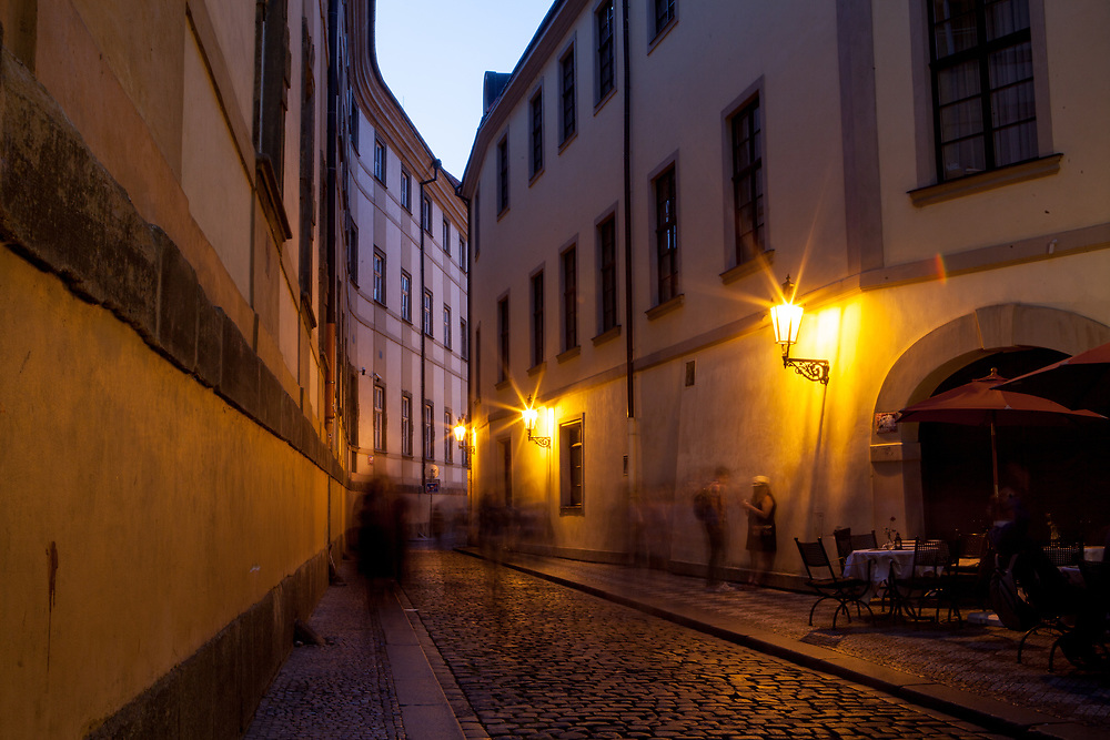 "Evening mood in a side street of ""Karlova street"" which leads from the end of Charles Bridge towards Old-Town Square. The street belongs to the Royal Route - the name was given to a route, which for many centuries had been taken by the Czech kings in a procession to their coronation in the St. Vitus Cathedral at the Prague Castle"