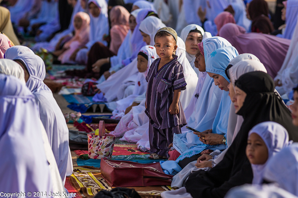 28 JULY 2014 - KHLONG HAE, SONGKHLA, THAILAND: Women and children during Eid services at Songkhla Central Mosque in Songkhla province of Thailand. Eid al-Fitr is also called Feast of Breaking the Fast, the Sugar Feast, Bayram (Bajram), the Sweet Festival and the Lesser Eid, is an important Muslim holiday that marks the end of Ramadan, the Islamic holy month of fasting.   PHOTO BY JACK KURTZ