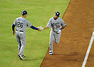 Jul. 15 2011; Phoenix, AZ, USA; Los Angeles Dodgers batter Juan Rivera (33) is congratulated by third base coach  Tim Wallach (26) after hitting a solo home run during the second inning against the Arizona Diamondbacks at Chase Field. Mandatory Credit: Jennifer Stewart-US PRESSWIRE..