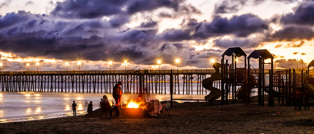 Bonfire At Sundown On The Beach At Oceanside Pier