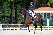 Astrid Rikheim - Cartier<br /> FEI European Dressage Championships for Young Riders and Juniors 2013<br /> © DigiShots