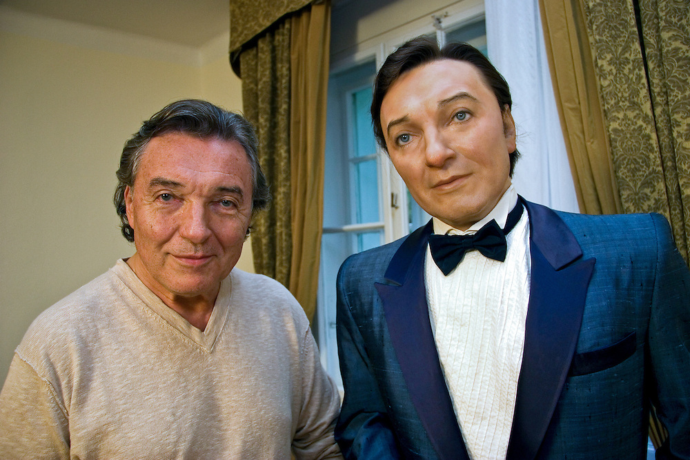 """Famous Czech popular singer Karel Gott with his own wax figure at his former museum """"Gottland"""" in Jevany close to Prague."""