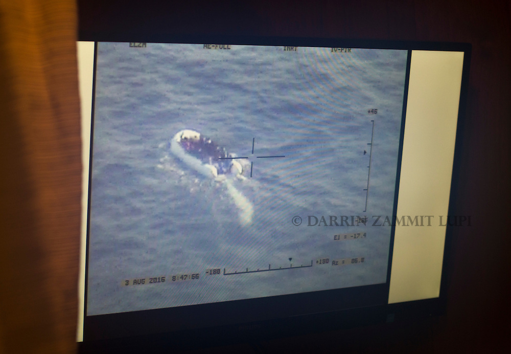 Live video footage transmitted from a Schiebel Camcopter S-100 drone showing a rubber dinghy packed with 118 migrants is seen on a monitor on board the Migrant Offshore Aid Station (MOAS) ship MV Phoenix some 20 miles (32 kilometres) off the coast of Libya, August 3, 2015.  118 migrants were rescued from a rubber dinghy off Libya on Monday morning . The Phoenix, manned by personnel from international non-governmental organisations Medecins san Frontiere (MSF) and MOAS, is the first privately funded vessel to operate in the Mediterranean.<br /> REUTERS/Darrin Zammit Lupi <br /> MALTA OUT. NO COMMERCIAL OR EDITORIAL SALES IN MALTA