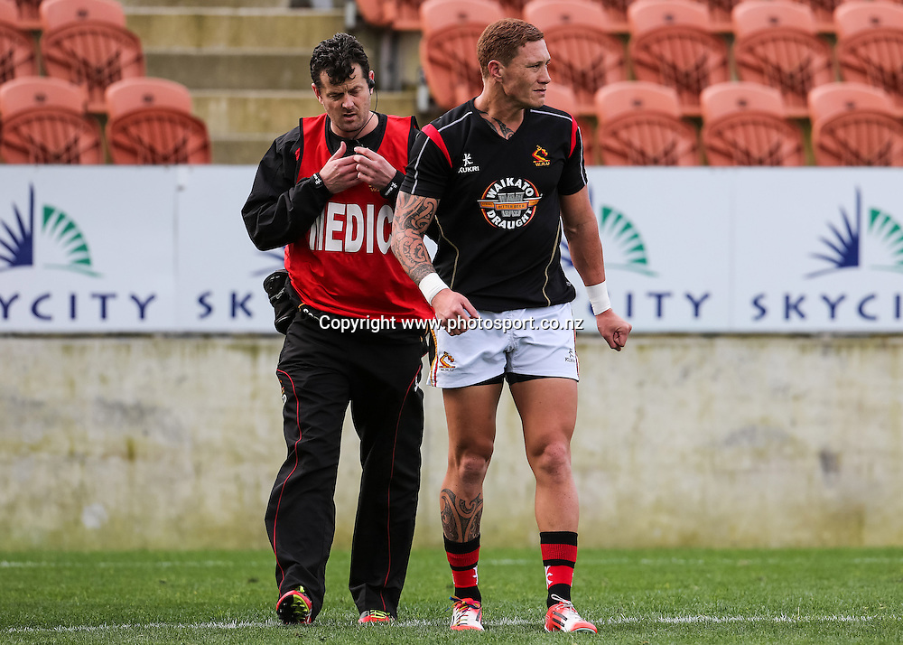 Waikato's Declan O'Donnell leaves the field after an injury to his leg shortly before the ITM Cup rugby match - Waikato v Counties Manukau at Waikato Stadium, Hamilton on Sunday 14 September 2014.  Photo: Bruce Lim / www.photosport.co.nz