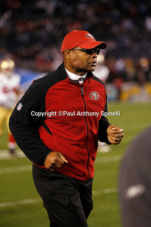 San Francisco 49ers head coach Mike Singletary jogs off the field at halftime during the NFL week 15 football game against the San Diego Chargers on Thursday, December 16, 2010 in San Diego, California. The Chargers won the game 34-7. (©Paul Anthony Spinelli)