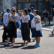 London, UK. 27 June 2019. UK Weather - The Hottest week in June 2019. Tourists taking selfes at Buckingham Palace, London, UK