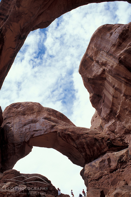 Arches National Park, UT.Visitors at Double Arch. Sandstone.