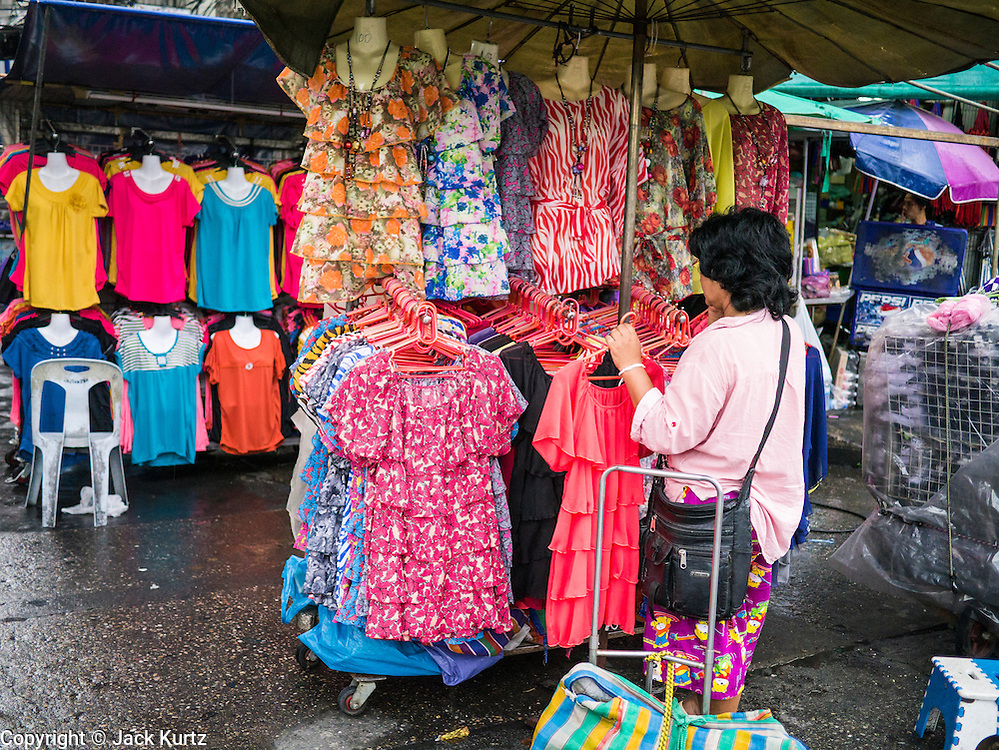 30 MAY 2013 - BANGKOK, THAILAND:   A woman shops for clothes at Bobae Market in Bangkok. Bobae Market is a 30 year old famous for fashion wholesale and is now very popular with exporters from around the world. Bobae Tower is next to the market and  advertises itself as having 1,300 stalls under one roof and claims to be the largest garment wholesale center in Thailand.   PHOTO BY JACK KURTZ