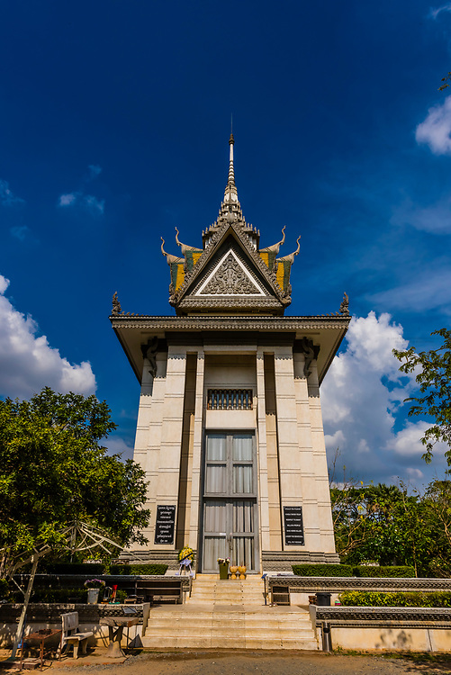 The memorial stupa displays over 5,000 skulls from the graves.Choeung Ek, the site of a former orchard and mass grave of victims of the Khmer Rouge - killed between 1975 and 1979 - about 17 kilometres (11 mi) south of Phnom Penh, Cambodia, is the best-known of the sites known as The Killing Fields, where the Khmer Rouge regime executed over one million people between 1975 and 1979. Over 17,000 people were brought here to be killed and buried in mass graves.