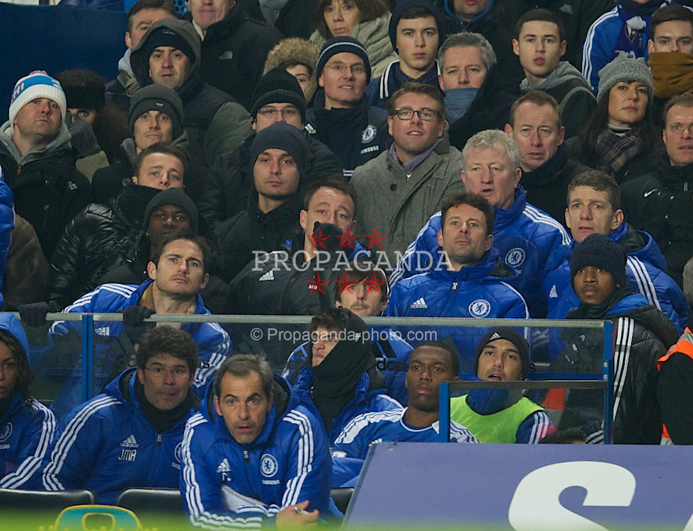 LONDON, ENGLAND - Sunday, February 5, 2012: Chelsea's injured captain John Terry watches from the bench as his side throw awat a three goal lead to draw 3-3 with Manchester United during the Premiership match at Stamford Bridge. (Pic by David Rawcliffe/Propaganda)