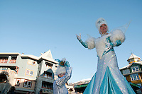 Street performers Dame Neige and Freimousse Givree entertain in Whistler village during the 2010 Olympic Winter Games.