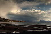 View from the Applecross Peninsula in the north-west Highlands of Scotland, across to the islands of Raasay and Skye. Big storm clouds gather off the coast.
