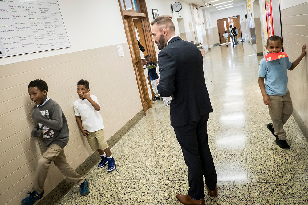 Eric Christopher, Leap ELA Instructional Coach at Turner Elementary School in Washington, D.C., monitors students in the hallway on Wednesday, May 4, 2017.
