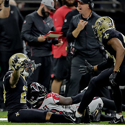 Nov 22, 2018; New Orleans, LA, USA; New Orleans Saints cornerback Marshon Lattimore (23) celebrates with safety Marcus Williams (43) after breaking up a pass to Atlanta Falcons wide receiver Calvin Ridley (18) during the second quarter at the Mercedes-Benz Superdome. Mandatory Credit: Derick E. Hingle-USA TODAY Sports