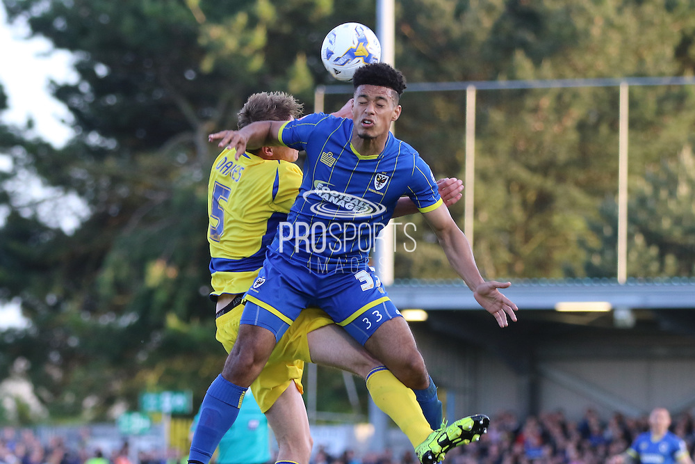 Lyle Taylor forward for AFC Wimbledon (33) and Tom Davies defender Accrington Stanley (5) in an ariel challenge during  the Sky Bet League 2 Play-Off first leg match between AFC Wimbledon and Accrington Stanley at the Cherry Red Records Stadium, Kingston, England on 14 May 2016. Photo by Stuart Butcher.