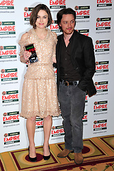 © under license to London News Pictures. 27/03/11. Keira Knightley and James Mcavoy on the Winners Boards at the Jamesons Empire Film Awards , Sunday 27th March 2011 at the Grosvenor House Hotel, Park Lane, London. Photo credit should read ALAN ROXBOROUGH/LNP