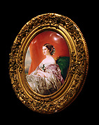 Empress Eugenie. Painted enamel on copper; frame; gesso and gilt on wood. Marie-Pauline Laurent (1805-1860) French (Sevres) dated 1855. A close copy of a painting by Franz Xaver Winterhalter (1806-1873), the portrait depicts Eugenie de Montijo de Guzman (1826-1920), wife of Emperor Napoleon 111.