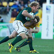 Pat  McCabe, Australia, cops a forearm from Schalk Burger, South Africa, during the South Africa V Australia Quarter Final match at the IRB Rugby World Cup tournament. Wellington Regional Stadium, Wellington, New Zealand, 9th October 2011. Photo Tim Clayton...