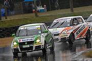 Hamilton's Shaun Lawrence leads Taupo's Mark Gibson on his way to winning the second race for the Suzuki Swift Sport Cup at the CRC 200 at Timaru International Motor Raceway on 22 January 2012. The CRC 200 is part of the New Zealand Premier Race Championship Series.