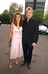 GORDON RAMSAY and his wife TANA at the NSPCC's Dream Auction held at The Royal Albert Hall, London on 9th May 2006.<br />