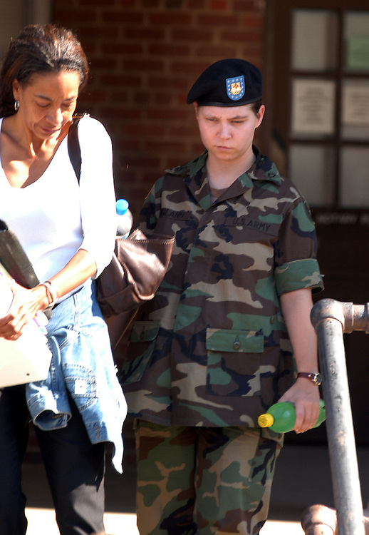 FORT BRAGG, NC- AUGUST 7: Pfc. Lynndie England leaves Saturday's hearing with Kathleen Johnson, a member of her legal defense team, at the Staff Judge Advocate Building on Fort Bragg in Fayetteville, NC on 8/7/04 for her Article 32 investigation hearing. England is charged with several counts, including one specification of conspiring to commit maltreatment of an Iraqi detainee, three specifications of assault against Iraqis, and several others. (Photo by Logan Mock-Bunting)
