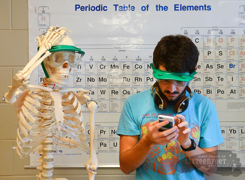 Gary Cosby Jr./Decatur Daily    Howard Walker stands beside a skeleton and a periodic table in an AP chemistry class at Lawrence County High School Thursday in Moulton.