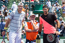 March 30, 2018 - Miami, Florida, United States - Juan Martin Del Potro, from Agentina, and John Isner, from the USA, pose at the net before the match with Jaques Lewkowicz, a guest from Itau Bank, the main sponsor of the Miami Open  in Miami, on March 30, 2018. (Credit Image: © Manuel Mazzanti/NurPhoto via ZUMA Press)