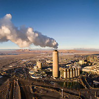 USA, New Mexico, Farmington, Aerial view of steam and smoke billowing from PNM San Juan Power Plant, a coal-fired electrical generating facility at sunset on winter morning.