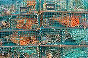 Lobster traps in coastal fishing village.<br />St. Martins<br />New Brunswick<br />Canada