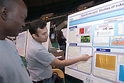 18208Student Reasearch & Creativity Activity Fair Spring 2007..Aderemi Adekola & Kushal Wijesundara look at the Spectroscopic Studies of InAs Quantum Dots