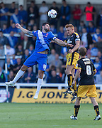 Billy Paynter (Hartlepool United) and Mark Roberts (Cambridge United) challenge for the high ball during the Sky Bet League 2 match between Hartlepool United and Cambridge United at Victoria Park, Hartlepool, England on 19 September 2015. Photo by George Ledger.