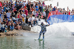 """""""Cushing Classic at Squaw Valley 16"""" - Photograph of a skier crossing a pond during the Cushing Classic at Squaw Valley, USA."""