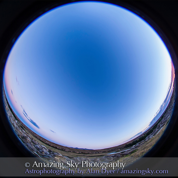A fish-eye lens shot of the twilight sky over Writing-on-Stone Provincial Park and its sandstone rock formations, in Alberta, Sept 1, 2013.