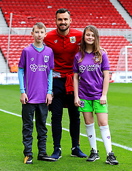 Bailey Wright of Bristol City poses for a picture with mascots - Mandatory by-line: Matt McNulty/JMP - 14/04/2018 - FOOTBALL - Riverside Stadium - Middlesbrough, England - Middlesbrough v Bristol City - Sky Bet Championship