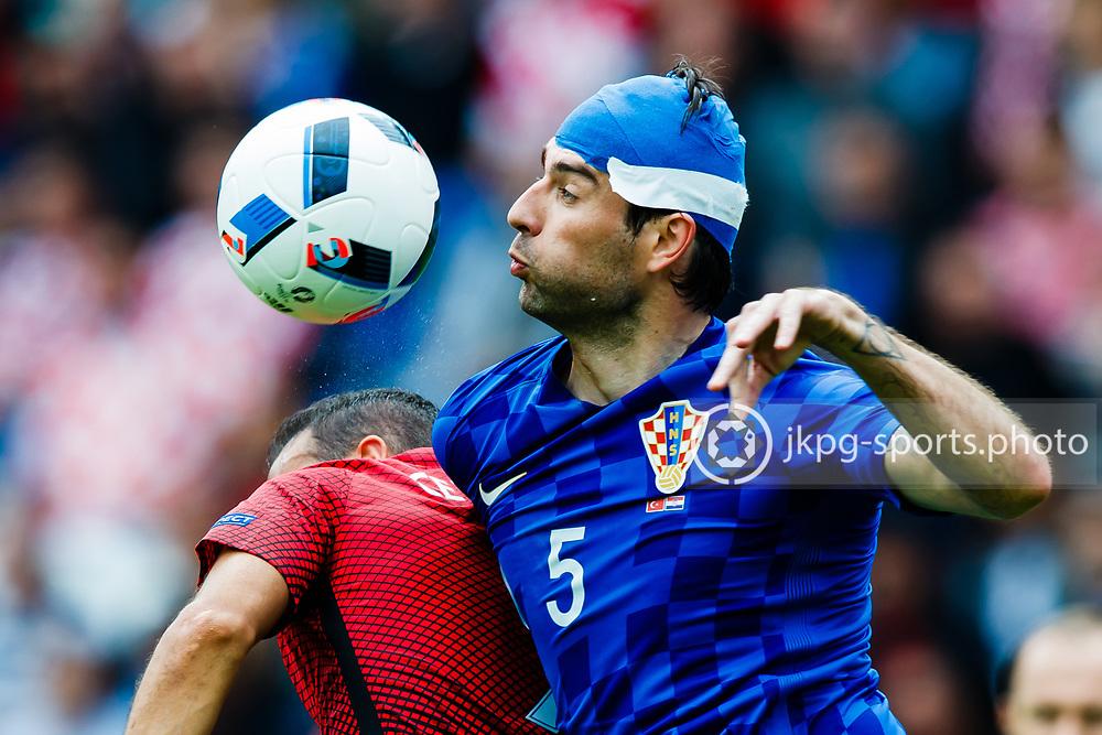June 12 2016, Euro 2016 Turkey - Croatia<br /> (9) Cenk Tosun, (TUR) and (5) Vedran Corluka, (CRO) focused on the ball.<br /> Editorial Use Only.<br /> Local caption:<br /> Em Fotboll, Frankrike - Rum&auml;nien, 20160612<br /> (5) Vedran Ćorluka, (CRO) och (9) Cenk Tosun, (TUR) fokuserade p&aring; bollen.<br /> Endast f&ouml;r redaktionellt bruk.<br /> &copy; Daniel Malmberg/IBL/All Over Press