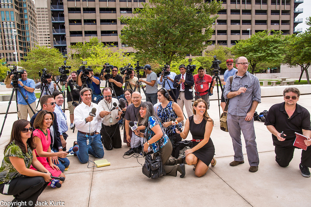 21 AUGUST 2012 - PHOENIX, AZ: Reporters wait for lawyers to come out of the US federal courthouse in Phoenix during a hearing about SB 1070. A handful of protesters waited outside the Sandra Day O'Connor Courthouse in Phoenix Wednesday while lawyers from the American Civil Liberties Union (ACLU) and Mexican American Legal Defense and Education Fund (MALDEF) sparred with lawyers from Maricopa County and the State of Arizona over the constitutionality of section 2B of SB 1070, Arizona's tough anti-immigrant law. Most of the law was struck down by the US Supreme Court in June, but the Justices let section 2B stand pending further review. The suit is being heard in District  Judge Susan Bolton's court. It was Judge Bolton who originally struck down SB 1070 in 2010. A ruling is expected later in the year.   PHOTO BY JACK KURTZ